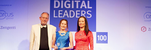 Emily Harper and CEO John Fisher accepting the Digital Leaders award in 2015.
