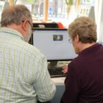 Mike Watson helps Mary Witt get online at Dorchester library