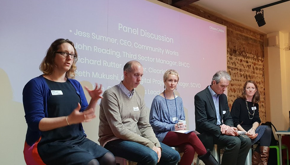 A panel of experts (Jess Sumner, Richard Rutter, Ellie Hale, John Reading and Beth Mukushi) seated in front of a presentation screen at the event.